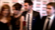 red carpet arrivals / winners room Agyness Deyn posing / The Inbetweeners cast posing and interview SOT / Jamie Campbell Bower and Joanne Froggatt...
