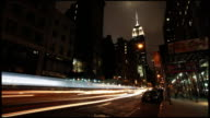 Empire State Building and 5th Ave traffic. Timelapse.