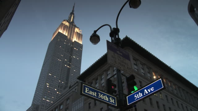 MS LA Empire State building at dusk, street name signs in foreground / New York City, New York, USA
