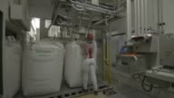 Employee check 1200 kg bags filled with sugar at Biosevs Santa Elisas Mill Sertaozinho State of Sao Paulo Brazil on Thursday September 24th 2015...