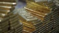 Employee hands arranging one kilogram gold bars at the YLG Bullion International Co headquarters in Bangkok Thailand on Wednesday Jan 13 Employee...