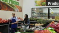 Employee helping customer in a warehouse supermarket