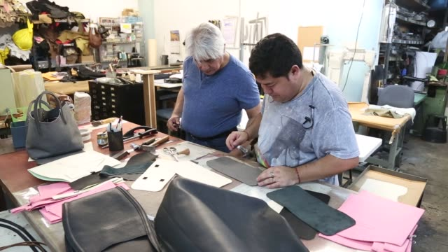 Employees assemble various bags at Justin Paul Inc a luxury handbag manufacturer in based in the Brooklyn Navy Yard in New York US on Thursday August...