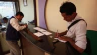 WS employees assist customers at a service counter inside a Civil Bank Ltd branch in Kathmandu MS Customers fill in slips inside a Civil Bank Ltd...