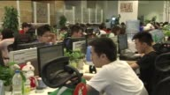 Employees at Xiaomi headquarters in Beijing China on June 3 Employees work on computers and laptops
