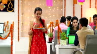 Employees celebrating diwali festival in the office, Delhi, India
