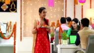 Employees celebrating diwali festival in the office, Delhi, India