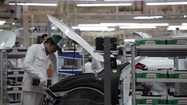 Employees collect parts at the honda motor co assembly for Honda motor company stock