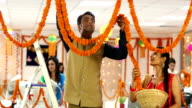 Employees decorating the office with marigold flower garlands, Delhi, India