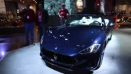 Employees dust and polish a Maserati GranCabrio Sport luxury automobile manufactured by Maserati SpA a unit of Fiat Chrysler Automobiles NV ahead of...