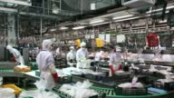 Employees inspect chickens moving along a conveyor and begin processing at the Harim Co factory in Iksan South Korea on Monday June 29 2015 Shots...
