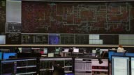 Employees monitor electricity output and usage data on a screen at the National Grid Plc control centre in Wokingham UK on Friday Oct 30 2015