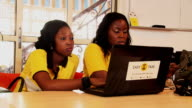 Employees of 'Easy Taxi' work on a computer laptop