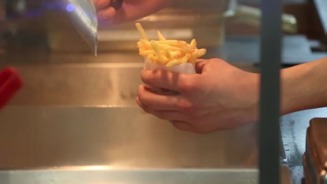 Employees prepare portions of french fries for meals inside a Burger King fast food restaurant in Moscow A Burger King restaurant in Moscow on April...