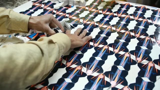 Employees prepare the panels for Adidas AG Capitano Replica soccer balls at the Forward Sports Ltd factory in Sialkot Punjab Pakistan on Tuesday Jan...