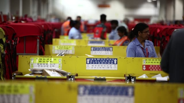 Employees sort parcels for delivery at the Mount Pleasant post sorting office operated by Royal Mail Plc in London UK on Wednesday July 19 2017