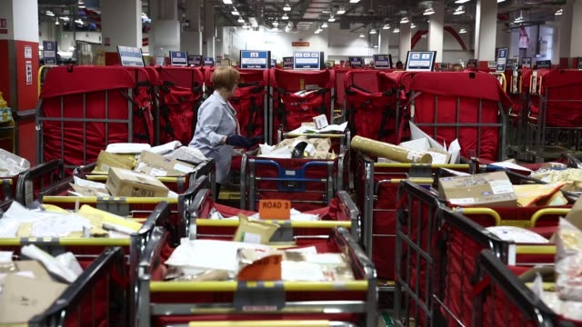Employees sort parcels for delivery at the Mount Pleasant post sorting office operated by Royal Mail Plc in London UK on Wednesday July 19 2017...