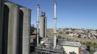 Employees sweep barley through a mesh floor after delivery from suppliers at the SABMiller Plc Maltings plant in Caledon South Africa on Thursday...