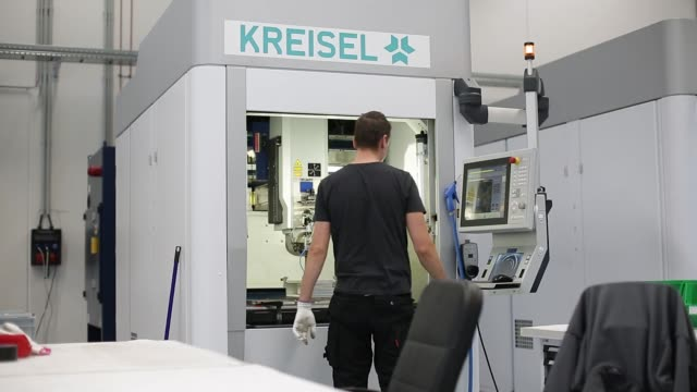 Employees test battery components at the Kreisel Electric GmbH research center and battery assembly plant in Rainbach Austria on Monday Oct 9 An...