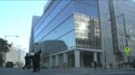 Employees walk toward the World Bank Building in Washington D.C. Available in HD.