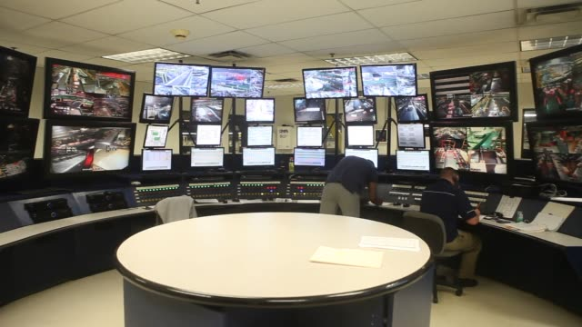 Employees watch video monitors at a control center at a Fed Ex Ground distribution center in Woodbridge NJ Thursday June 18 2015 Shots Wide shots pan...