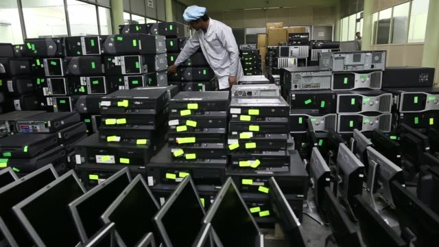 Employees work on computers inside the Attero Recycling Pvt facility in the Raipur industrial area of Bhagwanpur in Roorkee Uttarkhand India on...