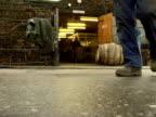 Empty barrels unloaded into a whiskey distillery Scotland 1990s