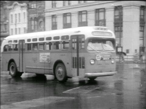 PAN empty bus driving on street past camera / Montgomery Bus Boycott AL / newsreel