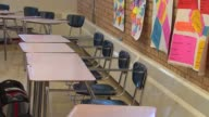 WGN Empty Desks in Classroom at Chicago Vocational Career Academy on September 25 2013 in Chicago Illinois