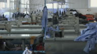 WS Empty factory floor with rows of sewing machines not being used / Ningbo, Zhejiang, China