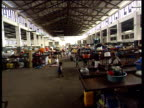 Empty factory used as a shelter for refugees after Mozambique floods refugees and belongings crowded inside Jul 00