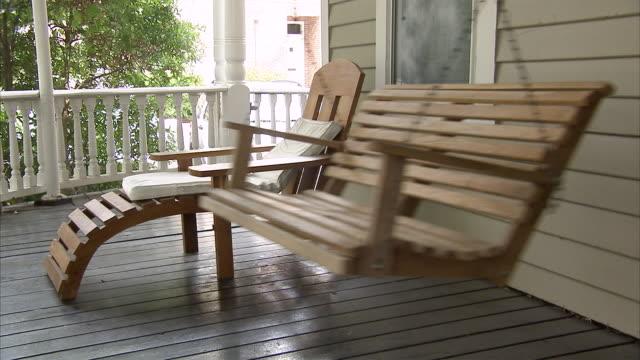 MS  Empty porch swing swinging