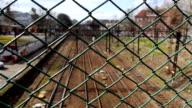 Empty rails behind fence