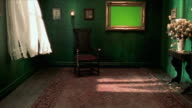 SLO MO MS Empty room with chroma key screen in frame and empty armchair, New York City, New York State, USA