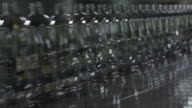 MS Empty soda beverage bottles on bottling line / soda and beverage manufacturing