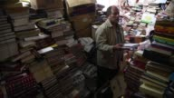 Emptying the bins of Bogota Colombian dustman Jose Alberto Gutierrez found a copy of the classic novel Anna Karenina and kept it