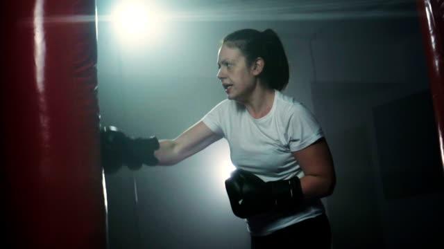 Energetic woman kickboxing