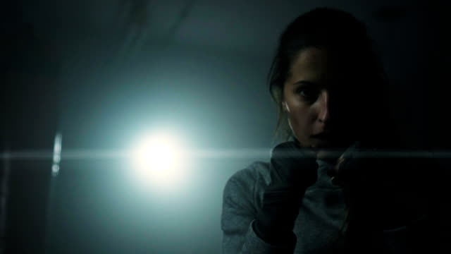 Energetic woman shadow boxing