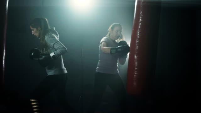Energetic women kickboxing
