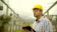 Engineer at power station using tablet
