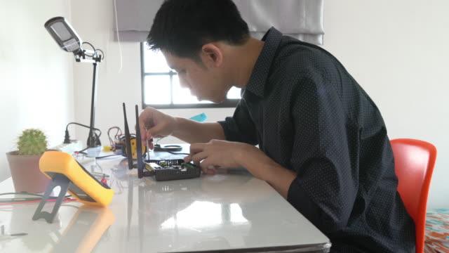 Engineer examine a robot