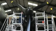 Engineer Keith Breachley works on the Lancaster bomber 'Just Jane' with the aim of getting it airworthy at Lincolnshire Aviation Heritage Centre on...