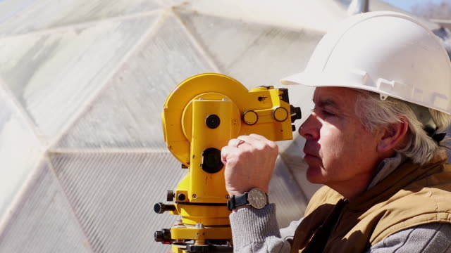 MS PAN Engineer looking through surveyor tool / Santa Fe, New Mexico, United States