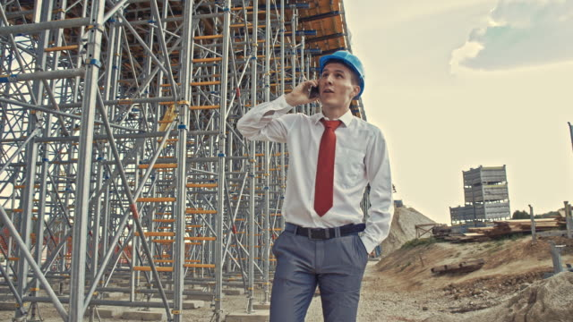 Engineer on the phone at the construction site