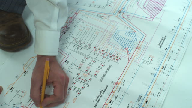 HD CRANE: Engineer reads blueprints