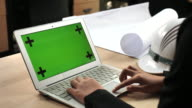 Engineer using Laptop with green screen