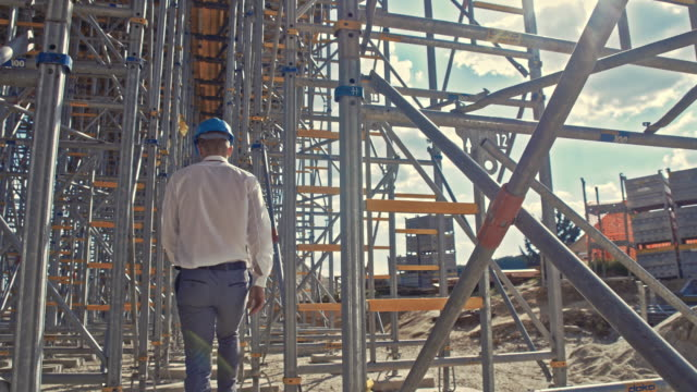 Engineer walking at the construction site
