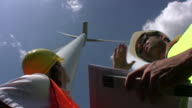 Engineer watching at wind turbine