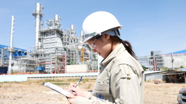 Engineer Working at Power Plant with Clipboard