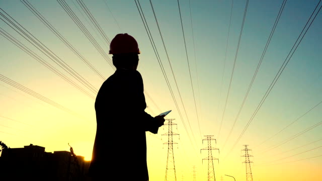 Engineer working at sunset